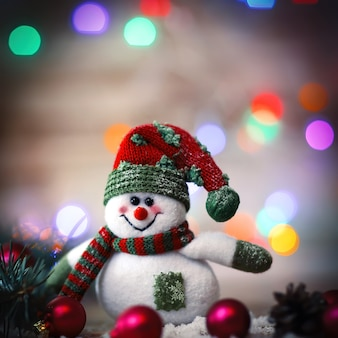Christmas card. toy snowman on christmas background.photo with place for text