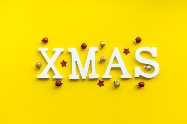 Christmas card white xmas letters on festive background.