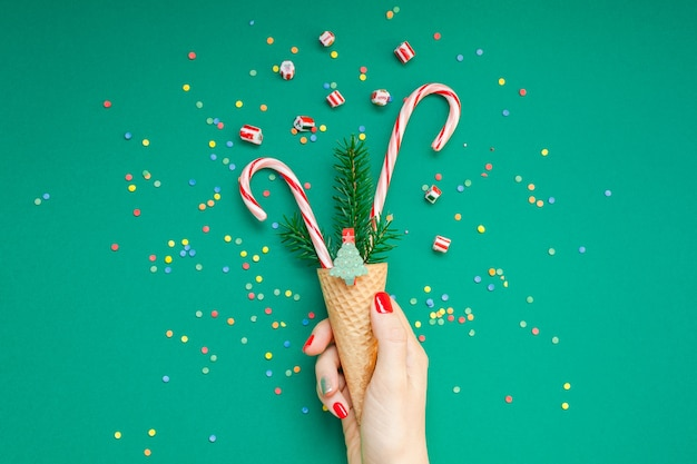 Christmas card with candy canes in waffle cone