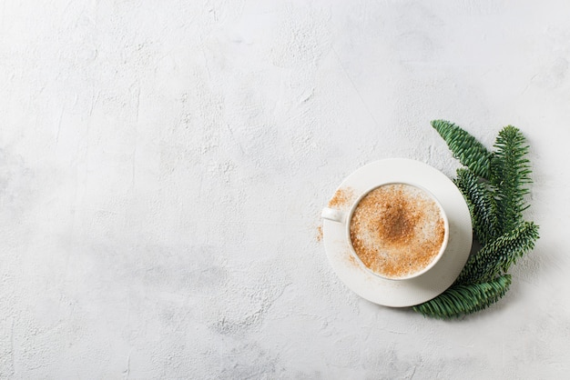 Christmas card with cup of coffe, pine, fir and gingerbread on white background, copy space, top view
