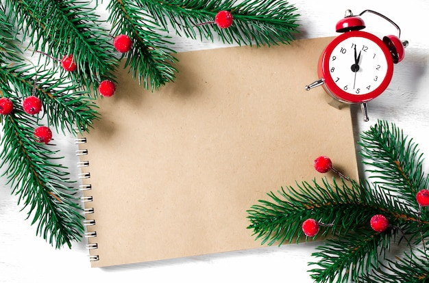 Christmas card with empty notebook and clock.