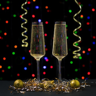 Christmas card with two glasses of sparkling wine. happy new year