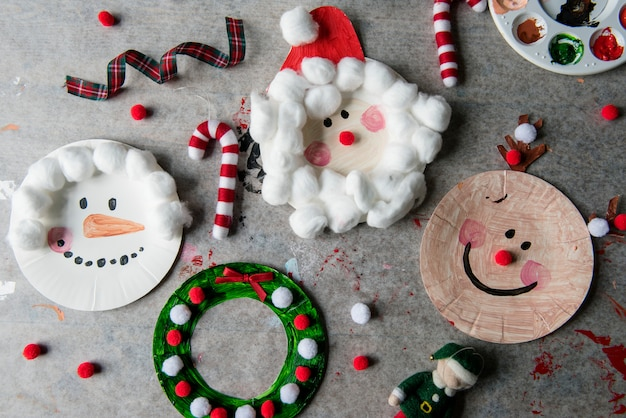 Christmas characters decorated on paper plates