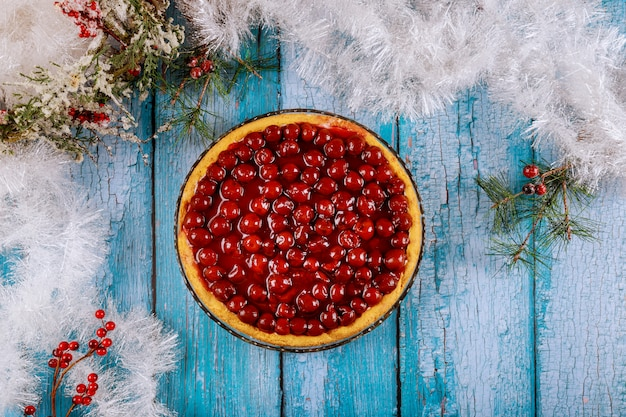 Christmas cheesecake with cherry topping and christmas decoration