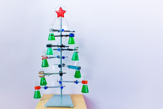 Christmas in the chemical laboratory. homemade christmas tree from flasks with colorful liquid