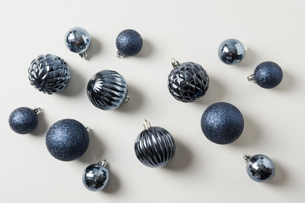 Christmas classic blue balls on pastel grey. top view. xmas pattern. holiday greeting card.