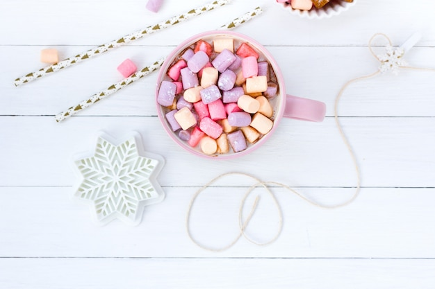 Christmas cocoa marshmallow pink cup and ginger biscuit white wooden table raspberry jam