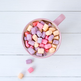 Christmas cocoa with marshmallow in a pink cup