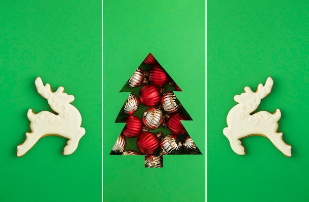 Christmas collage.christmas tree cut out on the green background and gingerbread in the form of white deer.