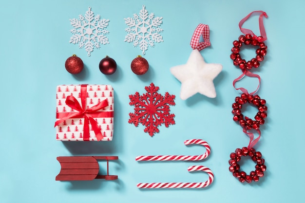 Christmas collection with candy canes, balls, red sleid on blue.