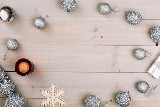 Christmas composition of baubles with candle