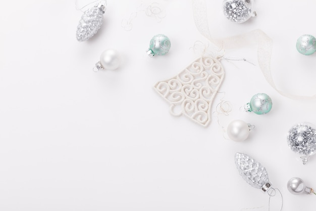 Christmas composition. christmas balls, blue and silver decorations on white background. flat lay, top view, copy space
