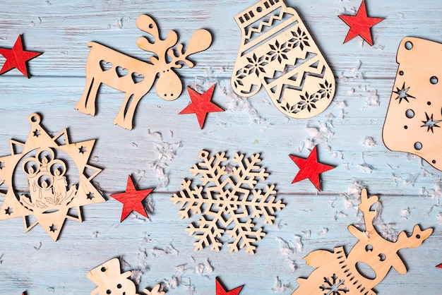 Christmas composition of christmas decorations and red stars on blue background.