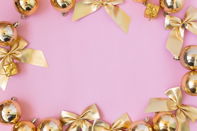 Christmas composition. christmas gifts, golden decorations on pastel pink