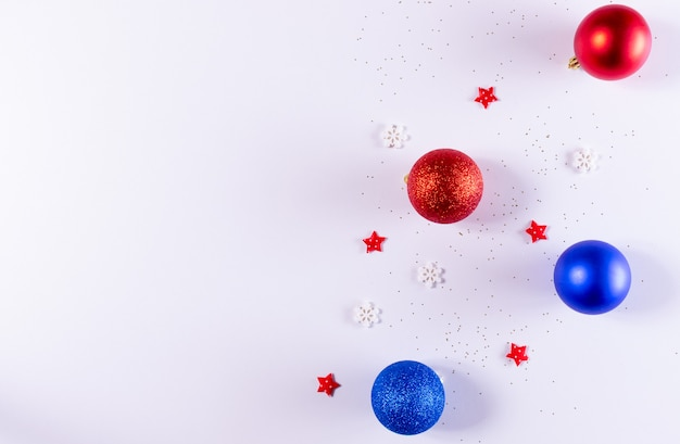 Christmas composition. christmas red and blue decorations on white . top view, copyspace .