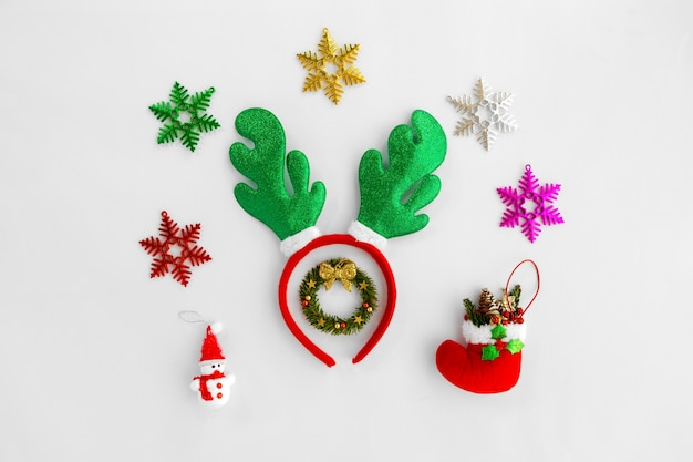 Christmas composition. christmas reindeer headband and ornaments on white background.