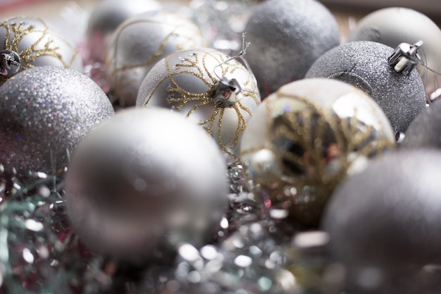 Christmas composition. christmas silver balls decorations on white tinsel background. close up