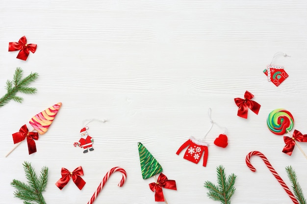 Christmas composition christmas sweets and candy canes pine branches and  new year wooden toys