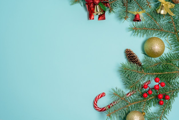 Christmas composition of christmas toys, candy and spruce branches