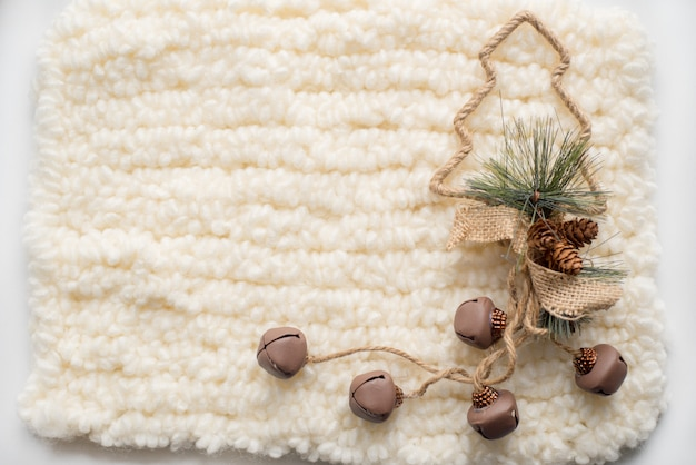 Christmas composition. christmas tree, knitted white scarf. place for your inscription