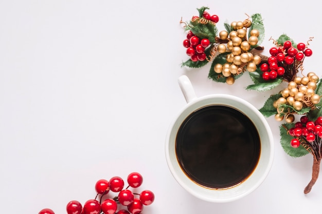 Christmas composition of coffee with berries