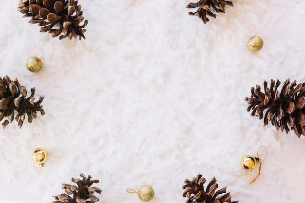 Christmas composition of cones on snow