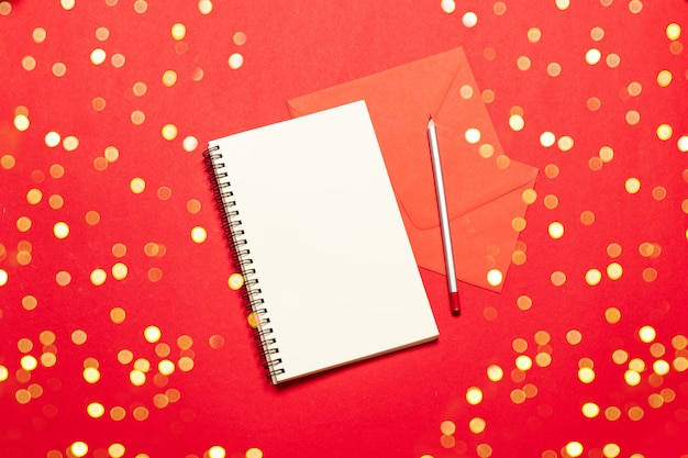 Christmas composition of an empty paper with a pencil to write a christmas wish list. holiday concept.