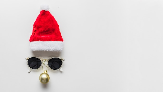Christmas composition of face from hat and sunglasses