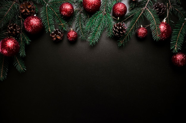 Christmas composition of fir tree branches with baubles and cones