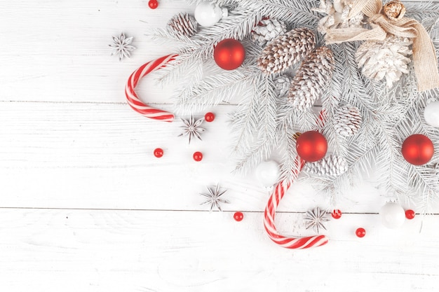 Christmas composition. frame made of fir branches on white wooden background