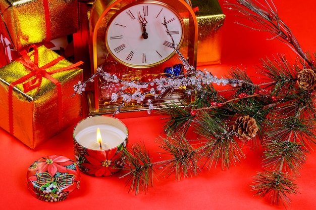 Christmas composition gift boxes and candle light. christmas and new year holidays red background