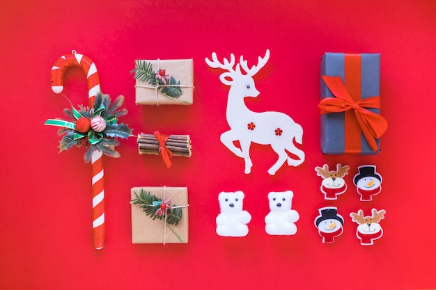 Christmas composition of gift boxes with candy cane