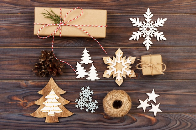Christmas composition. gift, christmas decoration, snowflake, pine cones. flat lay top view