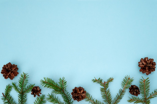 Christmas composition. green spruce branches, and dry open fir cones. christmas, new year, winter concept. flat lay, top view, copyspace.