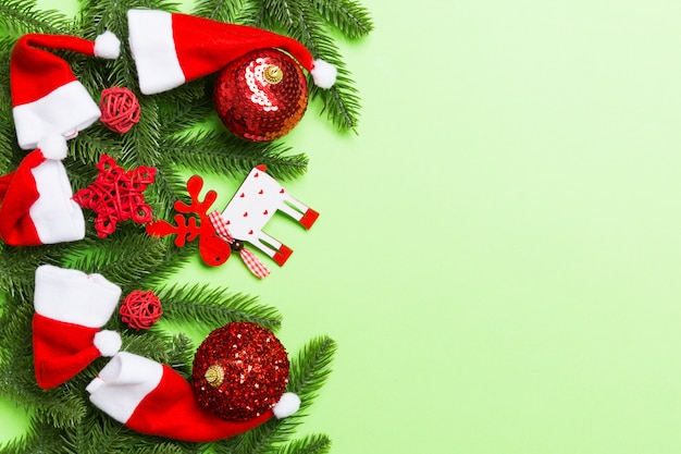 Christmas composition made of fir tree, balls and different decorations on colorful background.