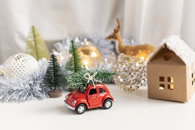 Christmas composition, new year - toy car with chtistmas tree on top
