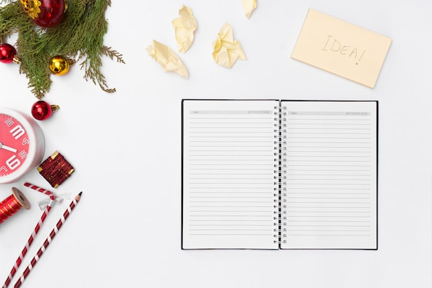 Christmas composition, notebook open pages, pen, fir branches on white background. christm