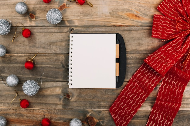 Christmas composition of notepad with band