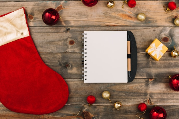 Christmas composition of notepad with christmas sock