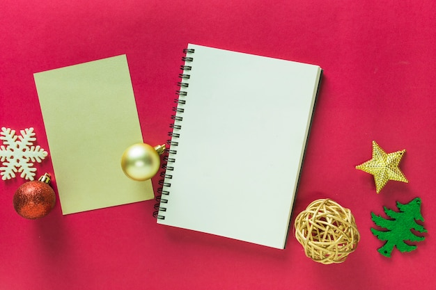Christmas composition of notepad with small toys