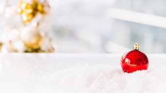 Christmas composition of bauble on table