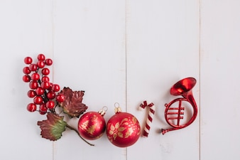Christmas composition of baubles with berries