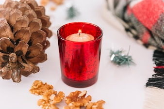 Christmas composition of candle in candlestick