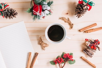Christmas composition of coffee with notebook
