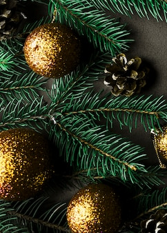 Christmas composition of fir tree branches with gold baubles