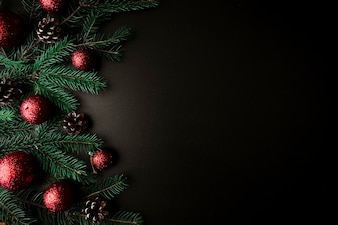 Christmas composition of fir tree branches with red baubles