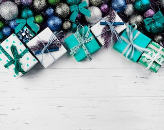 Christmas composition of gift boxes and colourful baubles