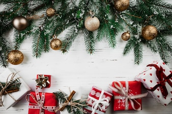 Christmas composition of gift boxes and fir tree branches