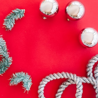 Christmas composition of shiny baubles with branches