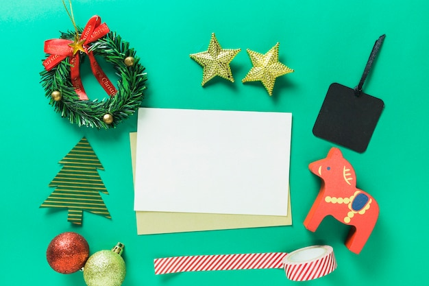 Christmas composition of paper with small toys